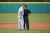 Xavier Musketeers head coach Scott Googins talks with umpire Kelly Culp during the game against the Penn State Nittany Lions at Coleman Field at the USA Baseball National Training Center on February 25, 2017 in Cary, North Carolina. The Musketeers defeated the Nittany Lions 7-5 in game two of a double header. (Brian Westerholt/Four Seam Images)
