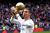 9th December 2017, Santiago Bernabeu, Madrid, Spain; La Liga football, Real Madrid versus Sevilla; Cristiano Ronaldo after receiving his fifth Golden Ball at the Eiffel Tower in Paris, presents the trophy to fans at the Santiago Bernabeu.