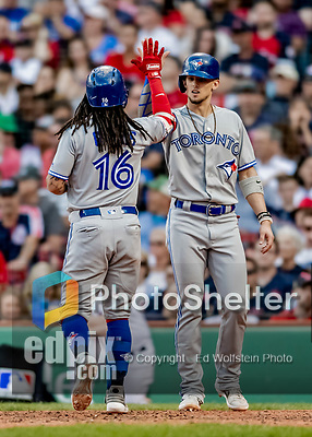 22 June 2019: Toronto Blue Jays shortstop Freddy Galvis  comes home to meet Cavan Biggio at the plate after Galvis hits a hits a 2-run home run in the 7th inning against the Boston Red Sox at Fenway :Park in Boston, MA. The Blue Jays rallied to defeat the Red Sox 8-7 in the 2nd game of their 3-game series. Mandatory Credit: Ed Wolfstein Photo *** RAW (NEF) Image File Available ***