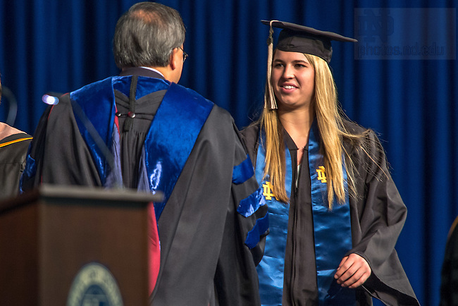 May 15, 2016; Hannah Huffman receives her diploma from Mendoza College of Business Dean Roger Huang at the 2016 Mendoza Undergraduate Degree Ceremony. (Photo by Matt Cashore/University of Notre Dame)