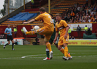 Steven Hammell boots the ball away in the Motherwell v Panathinaikos UEFA Champions League 3rd Qualifying Round 1st Leg match at Fir Park, Motherwell on 31.7.12.