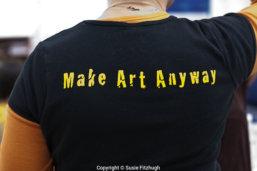 Teaching Artist Lauren Atkinson at work with her students, wearing her Arts Corps t-shirt.
