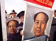 11 Nov 1971. Supporters brandish posters of Chairman Mao to welcome 46 delegates from the People's Republic of China arriving at JFK airport. On October 25th, 1971 the United Nations General Assembly admitted the People's Republic of China as a U.N. and permanent member of the Security Council, expelling the Republic of China (or nationalist Taiwan).