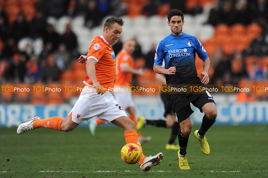 Anthony McMahon of Blackpool clears the ball from Andrew Surman of Bournemouth - Blackpool vs AFC Bournemouth - Sky Bet Championship Football at Bloomfield Road, Blackpool, Lancashire - 20/12/14 - MANDATORY CREDIT: Greig Bertram/TGSPHOTO - Self billing applies where appropriate - contact@tgsphoto.co.uk - NO UNPAID USE