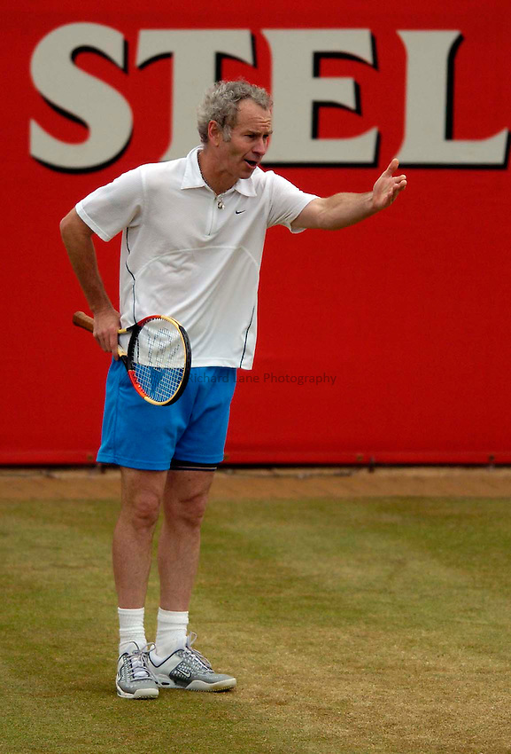 Photo. Jed Wee..Stella Artois Championships. .12/06/2005..John McEnroe rolls back the years with an exhibition match against Goran Ivanisevic with as many antics as there was action.