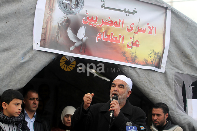 Sheikh Raed Salah, the leader of the Islamic Movement in Israel, speaks at a demonstration in support with Palestinian prisoners held in Israeli jails, some of whom are observing a hunger strike, in the West Bank city of Ramallah on February 11, 2013. Photo by Issam Rimawi