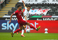18th July 2020; Liberty Stadium, Swansea, Glamorgan, Wales; English Football League Championship, Swansea City versus Bristol City; Liam Cullen of Swansea City gets his shot away despite the pressure from Zak Vyner of Bristol City