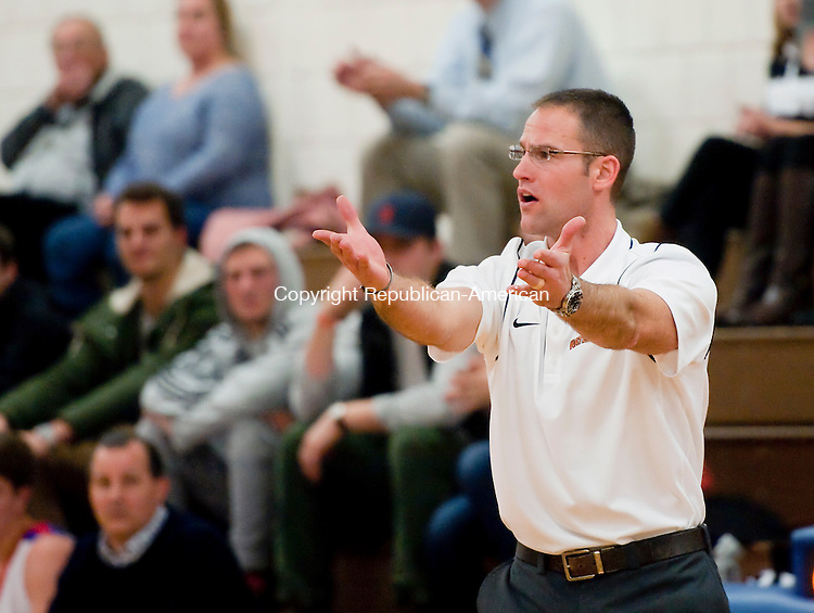 WOODBURY, CT--- -122915JS14--Watertown head coach Ed Sakl questions a call during their game against Nonnewaug  in the Nonnewaug Holiday Tournament Tuesday at Nonnewaug High School in Woodbury.<br /> Jim Shannon Republican-American
