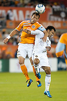 Brad Davis of the Houston Dynamo and Juninho of the Los Angeles Galaxy fight for the header during the regular season game between the Los Angeles Galaxy and the Houston Dynamo at Robertson Stadium in Houston, TX on April 10, 2010. Los Angeles 2, Houston 0.