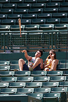 Baltimore Orioles fan casually throws back a bat that he caught after going into the stands during an Instructional League game against the Atlanta Braves on September 25, 2017 at Ed Smith Stadium in Sarasota, Florida.  (Mike Janes/Four Seam Images)