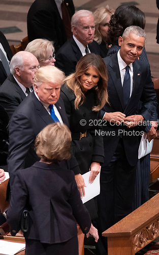 December 5, 2018 - Washington, DC, United States: Former First Lady Laura Bush greets United States President Donald J. Trump, First Lady Melania Trump and Barack Obama as she arrives for the state funeral service of former President George W. Bush at the National Cathedral.  <br /> Credit: Chris Kleponis / Pool via CNP