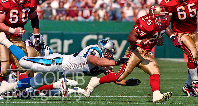 San Francisco 49ers vs. Carolina Panthers at Candlestick Park Sunday, October 17, 1999.  Panthers beat 49ers 31-29.  San Francisco 49ers running back Charlie Garner (25) runs away from Carolina Panthers defensive tackle Tim Morabito (90).