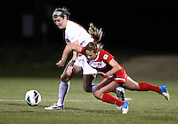 BOYDS, MARYLAND - April 06, 2013:  Caroline Miller (10) of The Washington Spirit is tripped by Olivia Brannon (5) of the University of Virginia women's soccer team in a NWSL (National Women's Soccer League) pre season exhibition game at Maryland Soccerplex in Boyds, Maryland on April 06. Virginia won 6-3.