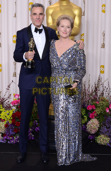 Daniel Day-Lewis, Meryl Streep.85th Annual Academy Awards held at the Dolby Theatre at Hollywood & Highland Center, Hollywood, California, USA..February 24th, 2013.pressroom oscars full length silver grey gray beads beaded dress black tuxedo white shirt arm over shoulder award blue winner trophy .CAP/ADM/RE.©Russ Elliot/AdMedia/Capital Pictures.