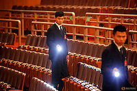 Security officers hold torches after the closing ceremony of National People's Congress (NPC) at the Great Hall of the People in Beijing, China, March 16, 2016. REUTERS/Damir Sagolj