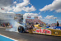 Oct 15, 2016; Ennis, TX, USA; NHRA top fuel driver Leah Pritchett burns out as she prepares to race the Papa John's new pan pizza-themed dragster during qualifying for the Fall Nationals at Texas Motorplex. Mandatory Credit: Mark J. Rebilas-USA TODAY Sports