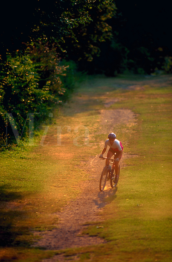 Woman mountain biking.