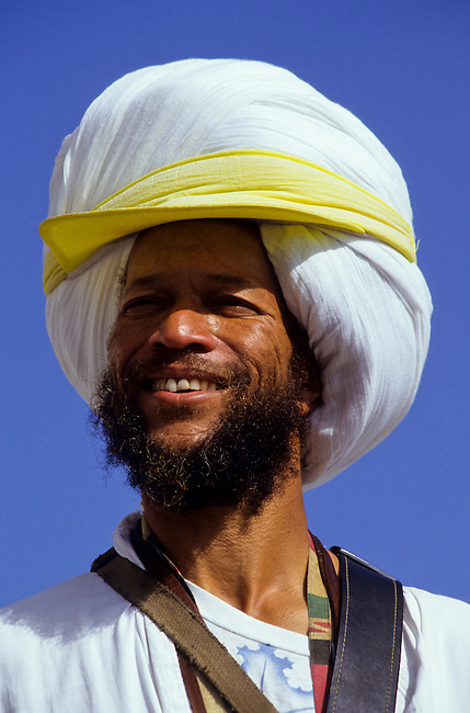 Portrait of electric guitar player with turban and rollar skates in Venice, Los Angeles, California, USA