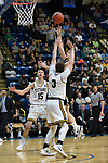 SALEM, VA - MARCH 17: Nebraska Wesleyan Prairie Wolves guard Nate Bahe (4) shoots over Wisconsin-Oshkosh Titans guard David Vlotho (3) and Wisconsin-Oshkosh Titans forward Adam Fravert (15) during the Division III Men's Basketball Championship held at the Salem Civic Center on March 17, 2018 in Salem, Virginia. Nebraska Wesleyen defeated Wisconsin-Oshkosh 78-72 for the national title. (Photo by Andres Alonso/NCAA Photos/NCAA Photos via Getty Images)