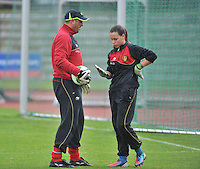 20131013 - BAMBERG , GERMANY : Belgian goalkeeper Ines Fernandez Gonzalez  pictured with GK Coach Bart Lemmens  during the female soccer match between Switzerland Women U17 and Belgium U17 , in the second game of the Elite round in group 6 in the UEFA European Women's Under 17 competition 2013 in the Fuchs Park Stadion - Bamberg  Sunday 13 October 2013. PHOTO DAVID CATRY