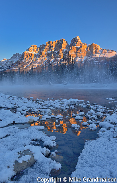 Castle Mountain reflected in the Bow River. at sunrise. Castle Junction, Banff National Park, Alberta, Canada