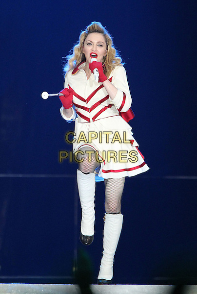 Madonna in concert, Moscow, Russia..August 7th, 2012.on stage live gig performance music full length white red cheerleader skirt top uniform marching baton singing gloves boots leg foot up.CAP/PER/VV.©VV/PersonaStars/CapitalPictures