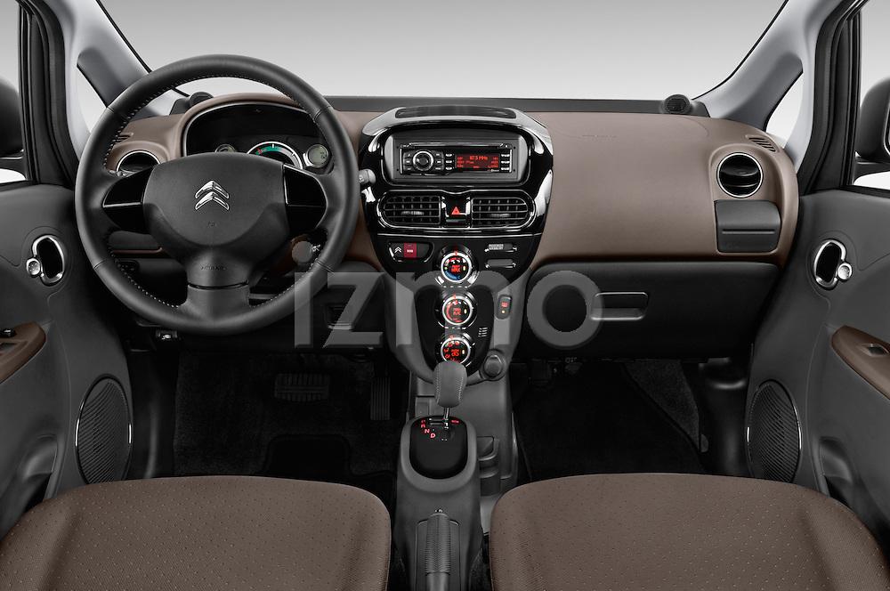 Stock photo of straight dashboard view of 2016 Citroen C-Zero Confort 5 Door Micro Car Dashboard