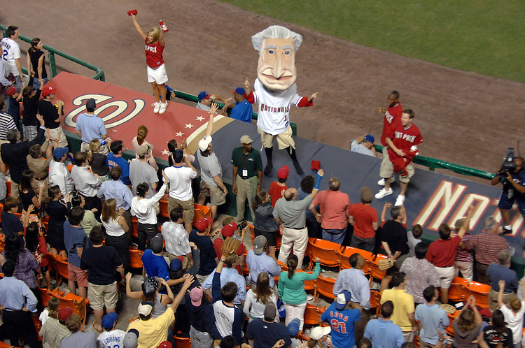 "George Washington leads the crowd in ""Take Me Out to the Ball Game,"" during the seventh inning stretch of the Nationals game at RFK stadium."