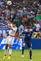 Mexico's forward Eduardo Herrera (20) and United States' defender Ventura Alvarado (19) during an international friendly at the Alamodome, Wednesday, April 15, 2015 in San Antonio, Tex. USA defeated Mexico 2-0. (Mo Khursheed/TFV Media via AP Images)