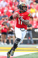 College Park, MD - September 22, 2018:  Maryland Terrapins quarterback Kasim Hill (11) attempts a pass during the game between Minnesota and Maryland at  Capital One Field at Maryland Stadium in College Park, MD.  (Photo by Elliott Brown/Media Images International)