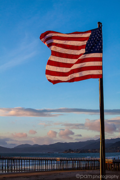 Flag at sunset with Pismo Beach pier in the background