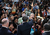 Arlington, VA - September 8, 2009 -- United States President Barack Obama (C) shakes hands with students and faculty after delivering a national address directed to students across the nation, at a back to school event at Wakefield High School in Arlington, Virginia, USA, 08 September 2009.  President Obama delivered remarks to encourage students to study hard, stay in school and take responsibility for their own education on the first day of the school year for many children across America.  .Credit: Michael Reynolds - Pool via CNP