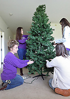 (L-R) Teacher Stephanie Ganser and students Laura Quintero, Grace Shafer and Grace Stewart assemble Christmas Trees at Magnolia Springs Bridgewater, an assisted living community in Carmel.