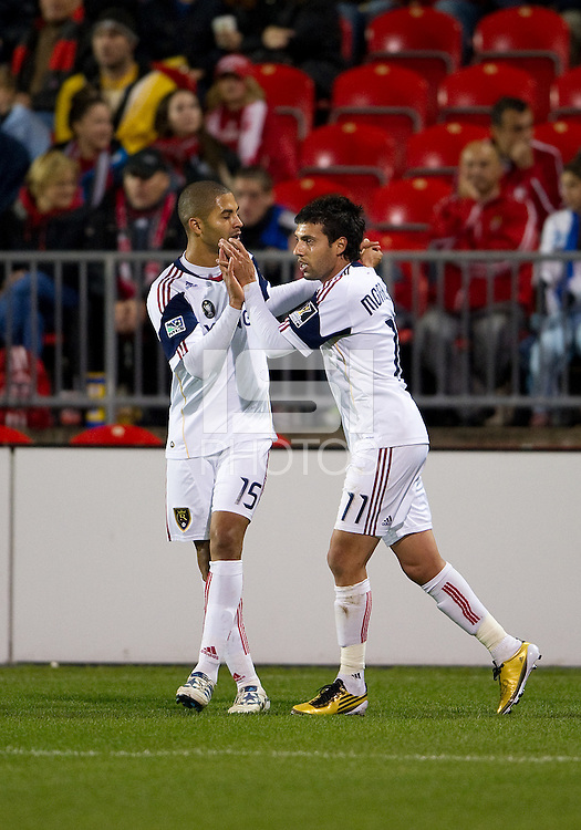 28 September 2010: Real Salt Lake midfielder Javier Morales #11 celebrates his equalizing goal in the 68th minute of the second half with Real Salt Lake forward Alvaro Saborio #15 during a CONCACAF Champions League game between Real Salt Lake and Toronto FC at BMO Field in Toronto..Final score was 1-1...