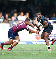 Chris Feauai-Sautia of The St.George Queensland Reds loos to tackle S'busiso Nkosi of the Cell C Sharks during the super rugby match between the Cell C Sharks and the Queensland Reds at Jonsson Kings Park Stadium in Durban, South Africa 19th April 2019. Photo: Steve Haag / stevehaagsports.com