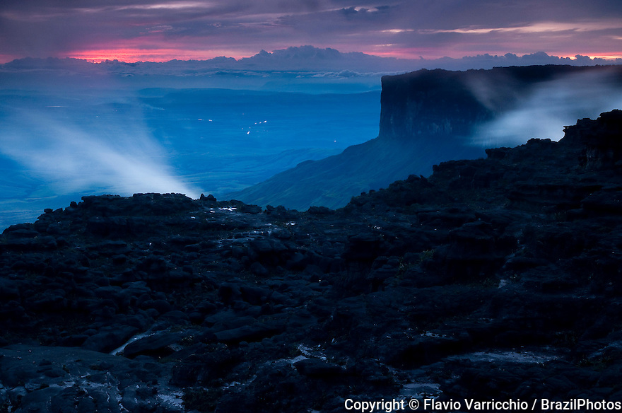 Sunset at  Mount Roraima ( also known as Roraima Tepui or Cerro Roraima in Spanish, and Monte Roraima in Portuguese ), the highest of the Pakaraima chain of tepui plateau in South America - Mount Roraima lies on the Guiana Shield in the southeastern corner of Venezuela's Canaima National Park - the tabletop mountains of the park are considered some of the oldest geological formations on Earth, dating back to some two billion years ago in the Precambrian Era. The mountain includes the triple border point of Venezuela, Brazil and Guyana.