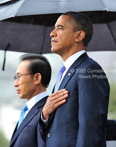 United States President Barack Obama and President Lee Myung-bak of South Korea during an arrival ceremony on the South Lawn of the White House in Washington, D.C. on October 13, 2011.  UPI/Kevin Dietsch.Credit: Kevin Dietsch / Pool via CNP