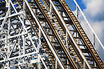 Roller Coaster Superstructure And Tracks On A Beautiful Sunny Day
