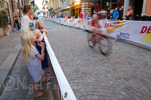 24 AUG 2013 - STOCKHOLM, SWE - Spectators watch the bike during the elite women's ITU 2013 World Triathlon Series round in Gamla Stan in Stockholm, Sweden (PHOTO COPYRIGHT © 2013 NIGEL FARROW, ALL RIGHTS RESERVED)