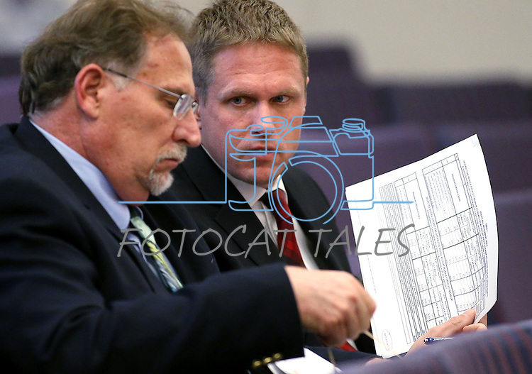 Gov. Brian Sandoval's Chief of Staff Mike Willden, left, and Deputy Chief of Staff Chris Nielsen talk in a hearing at the Legislative Building in Carson City, Nev., on Tuesday, May 5, 2015. <br /> Photo by Cathleen Allison