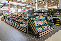 Fresh produce displayed on supermarket shelving
