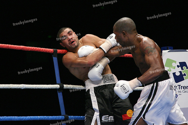 One Last Round, Jeff Fenech v Azuma Nelson Fight Night..Melbourne, Vodafone Arena 24-6-08..William Kickett (L) back on the ropes as Gairy St Clair is on the attack during there Super Featherweight title fight..Photo: Grant Treeby
