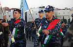 Palestinian Fatah movement fighters parade during a rally marking the 50th anniversary of the founding of the Fatah movement, in the West Bank city of Ramallah December 31, 2014. Abbas signed on to 20 international agreements on Wednesday, including the Rome Statute of the International Criminal Court, a day after a bid for independence by 2017 failed at the United Nations Security Council. Photo by Shadi Hatem