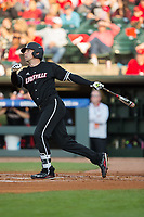 Drew Ellis (10) of the Louisville Cardinals follows through on a solo home run against the Notre Dame Fighting Irish in Game Eight of the 2017 ACC Baseball Championship at Louisville Slugger Field on May 25, 2017 in Louisville, Kentucky.  The Cardinals defeated the Fighting Irish 10-3.  (Brian Westerholt/Four Seam Images)