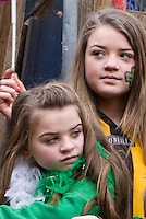 St Patricks Day parade High Street Digbeth.Two Girls Different generations on Parade float Camp Hill Bordesley
