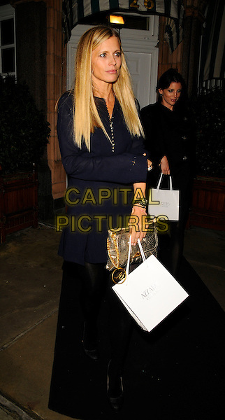 LAURA BAILEY .The Jemima Khan for Azzoro Spring 09 collection launch & dinner reception, Harry's Bar, South Audley St., London, England..September 15th, 2008.full length black dress hand in pocket goody bag blue gold clutch bag .CAP/CAN.©Can Nguyen/Capital Pictures.