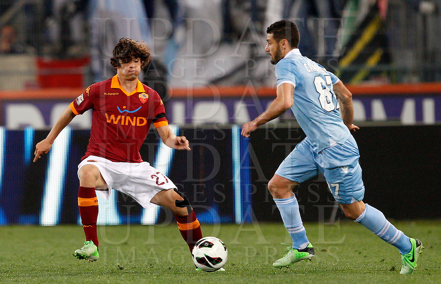 Calcio, Serie A: Roma vs Lazio. Roma, Stadio Olimpico, 8 aprile 2013..Lazio midfielder Antonio Candreva, right, is challenged by AS Roma defender Dodo', of Brazil, during the Italian serie A football match between A.S. Roma  and Lazio at Rome's Olympic stadium, 8 april 2013..UPDATE IMAGES PRESS/Riccardo De Luca