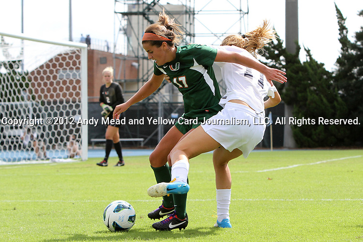 30 September 2012: Miami's Kim Hutchinson (17) and UNC's Kelly McFarlane (11). The University of North Carolina Tar Heels defeated the University of Miami Hurricanes 6-1 at Fetzer Field in Chapel Hill, North Carolina in a 2012 NCAA Division I Women's Soccer game.