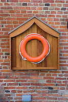 In case of emergencies a lifebuoy is situated on the wall next to the front door of a converted canalside warehouse in Nottingham