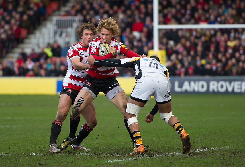 Gloucester Rugby's Billy Twelvetrees is tackled by Wasps' Charles Piutau<br /> <br /> Photographer Ashley Western/CameraSport<br /> <br /> Rugby Union - Aviva Premiership Round 15 - Gloucester Rugby v Wasps - Saturday 5th March 2016 - Kingsholm Stadium - Gloucester<br /> <br /> &copy; CameraSport - 43 Linden Ave. Countesthorpe. Leicester. England. LE8 5PG - Tel: +44 (0) 116 277 4147 - admin@camerasport.com - www.camerasport.com